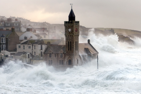 The heavy seas batter Porthleven