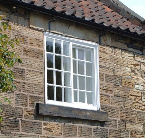 Yorkshire sliding sash - slides sideways and difficult to weatherproof!